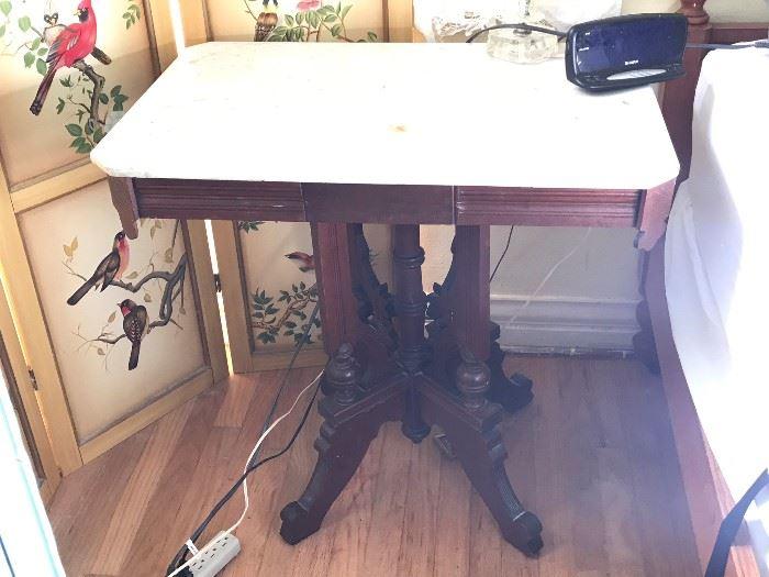Eastlake marble top table 75.00