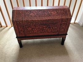 Carved wooden chest with tribal motif