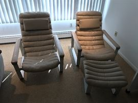 Pair of Aksel lounge chairs with ottoman