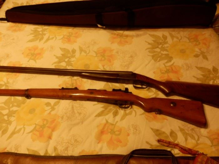 Remington SxS (Double Barrel) 12 GA.  Shotgun Model 1894 Hammerless w/Shell Ejectors ............. ........................Gewehr German M98 1917 Mauser 8mm with Mannlicher Stock.   Both guns are in excellent shape.