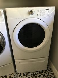 Electric washer & Dryer like new both on pedestals.