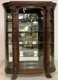 Heavily carved oak triple bow glass china cabinet