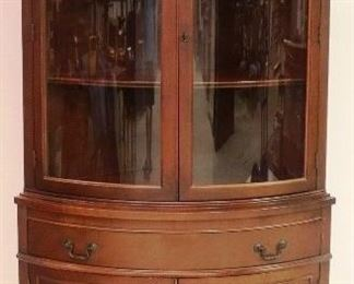 Mahogany bowed glass corner cabinet