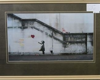 Girl with Balloon by graffitie artist Banksy
