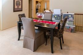 Black 60 inch table with six upholstered chairs. With leaf extends to 80 inches.