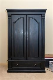 Black Armoire or entertainment cabinet.