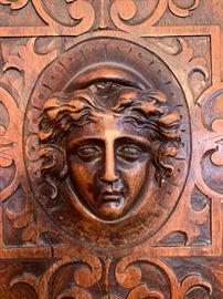 Close-up of antique French oak hand carved cabinet.