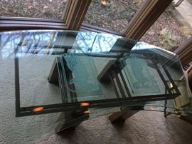 Fabulous curved glass desk on a heavy metal painted base. Eagle figures are etched into the glass top.