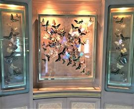 Framed butterflies. Largest measures 38 inches by 43 inches. Two side pieces measure 45 inches tall by 13 inches across.