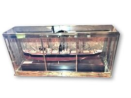 Cabinet measures 62 inches long by 14 inches deep by 29 inches high. Ship measures approximately 50 inches long.
