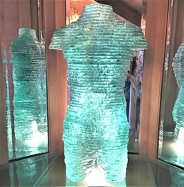 Life sized green glass slab torso sculpture.