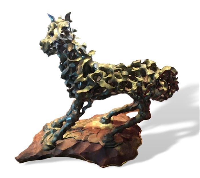 Heavy bronze sculpture, artist signed.