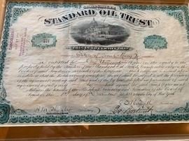 Rare antique stock certificate signed by John D. Rockefeller and made out to the Estate of Josiah Macy - the founder of Macy's