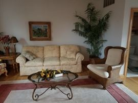 Elegant furnishings; sofa by Lexington Furniture; rattan chair is sold