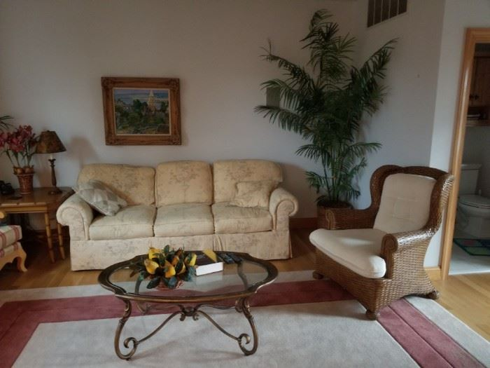 Elegant furnishings; sofa by Lexington Furniture; rattan chair is sold