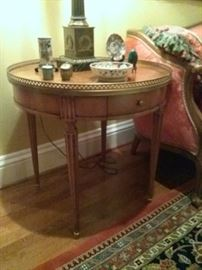 Pair of Fine End Tables by Baker in the Louis XVI Style with round fluted legs and a brass gallery.