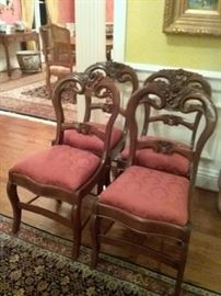 4 Carved Victorian Chairs with floral and berry motif on the crest rail.