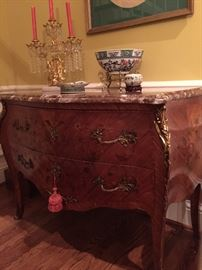 Late 19th Century Classic Louis XV bombe marquetry commode with marble top and ormolu.