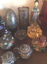 Japanese cloisonne teapots from 1860s; egg, bowl and vase in vintage translucent Chinese plique a jour cloisonne; cloisonne Court Lady figurine; gold cast stone Laughing Buddha; amber and green cast stone Foo Dog