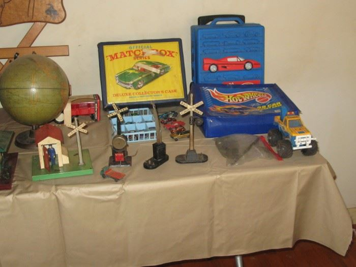 Hot Wheels and Match Box cases, with cars