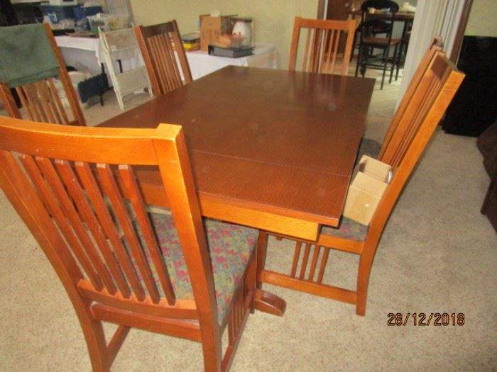 """BASSET MISSION STYLE DINING ROOM SET WITH 6 CHAIRS, 2 (12"""" LEAVES) AND PADS.  TABLE IS ABOUT 5 3/4"""" LONG"""
