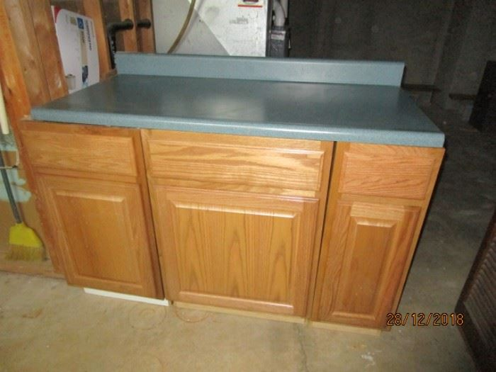 3 PIECES NEW KITCHEN CABINET WITH 4' BLUE FORMICA TOP