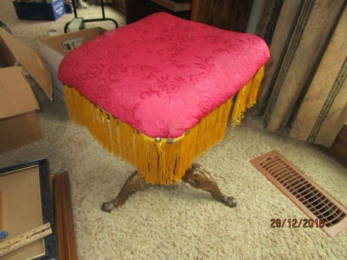 ANTIQUE PIANO STOOL WITH BRASS LEGS