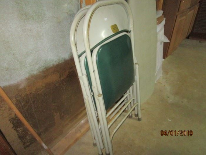 two of four folding chairs