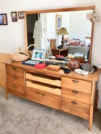 Mid Century Heywood Wakefield dresser. There is a door in front that pulls down to cover the draws. forgot !!!