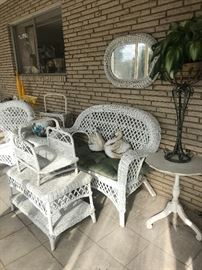 Sunporch filled with white wicker furniture