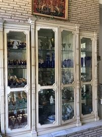 "Oversized (6'11"" by 6'8"") display cabinet filled with crystal, porcelains, and Lladro"