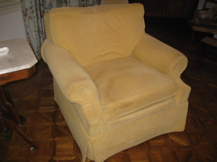 One of a pair of swivel upholstered chairs by the Charles Stewart Co.