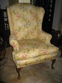 One of a pair of floral wing back chairs