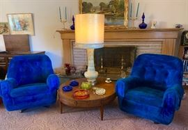 A pair of vintage Light cobalt blue swivel chairs.