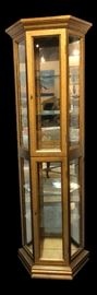 Gold 2-door curio cabinet from the mid 20th century. The piece is in great condition, and the light works. 24ʺW × 10.5ʺD × 72ʺH