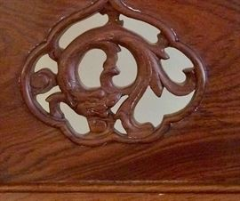 Close up of one of the chair carvings.