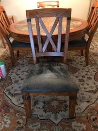 Dining room table with leaf and 4 chairs. Unique design with stone.