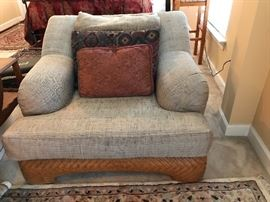 This chair is perfect for a TV room. When you sit in the chair you'll sink into it. It's very comfortable. The wicker bottom is attractive and adds appeal.