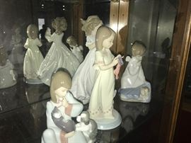 9 pieces of lladro fiqurines