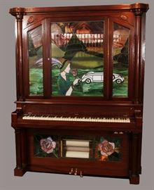 """CLARENDON HADEROFF PIANO CO., CARVED MAHOGANY UPRIGHT PIANO/NICKELODEON, C. 1911, H 78"""", L 60"""", D 27"""", INSET WITH FIGURAL LEADED GLASS, Lot 84"""
