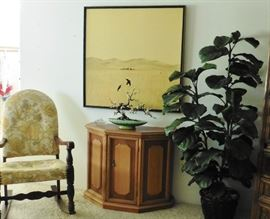 Console cabinet, rocking chair, original painting by Duane Armstrong.