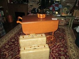 Wooden cart and vintage luggage
