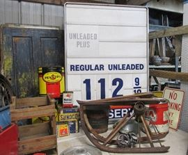 Large Vintage gas station pricing sign, pair of Antique Model T automobile winter weather skis, vintage petroleum cans, antique Model T automobile Socony Standard Oil swivel 5 gallon Square oil can wood dispenser