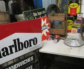 Vintage general store Marlboro tobacco shop sign, assorted vintage metal agriculture advertising signs, Ohio lottery sign, various vintage automobile wheel hubcaps