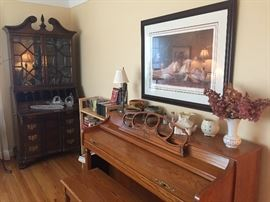 In the living room: Wurlitzer Piano, Robert Olson framed prints