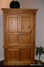Modern pine Armoire, 81 inches tall, 22 inches deep, and 48 inches across