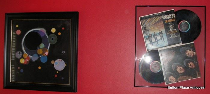 Vasily Kadinsky print  on the left and a Beatles Collage on the right.