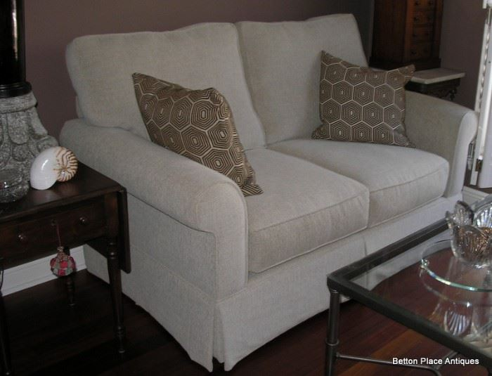 As new Loveseat, this is excellent, 64 inches wide, 38 inches deep.