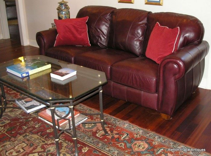 Fabulous Lane  Leather Sofa, Glass top Metal Coffee Table and a 8ft 8 inch x 12 ft Karastan carpet.
