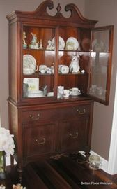 Antique Display hutch , Mahogany with Glass front doors measuring 37 1/2 inches wide, 13 1/2 inches deep and 73 inches tall.
